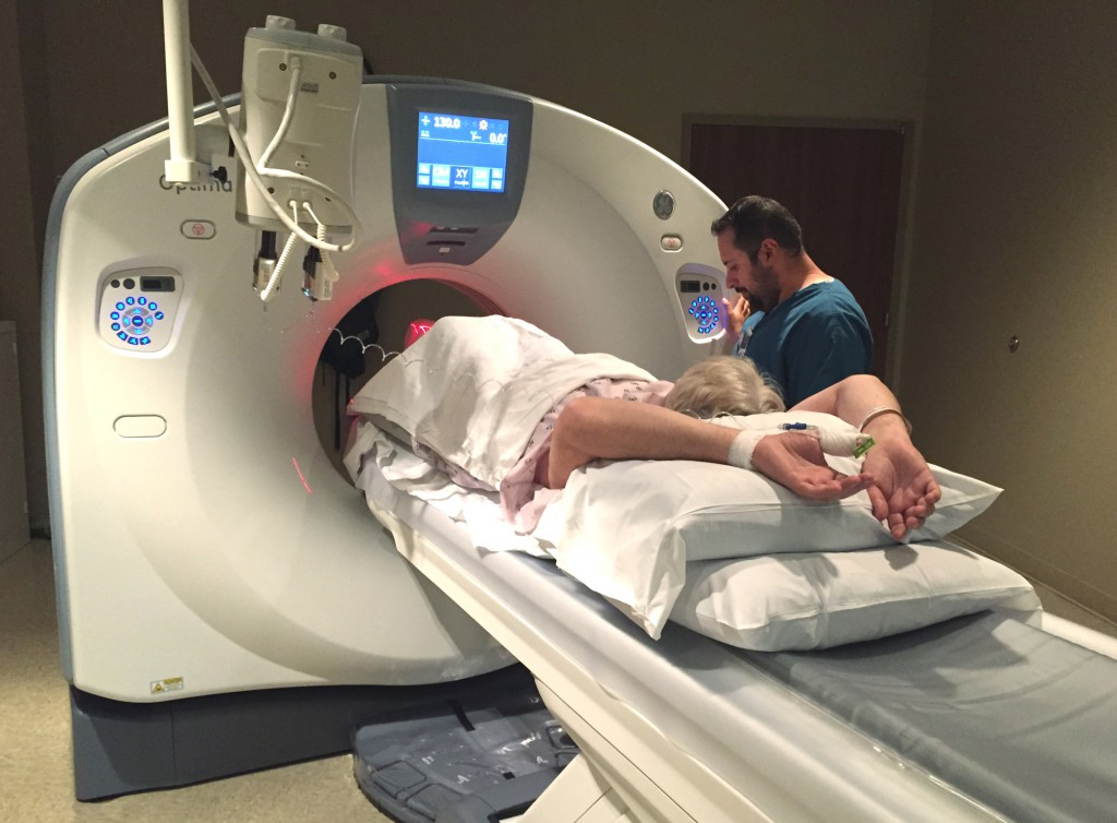 A member of the Southwest Medical Center care team helps perform a CT scan on a patient Friday afternoon inside a new 64-slice CT scanner located in the Diagnostic Imaging department.